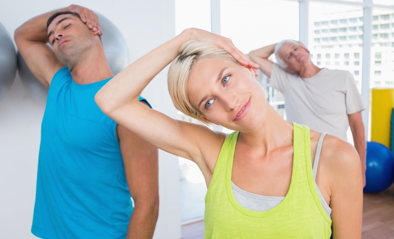 woman-with-friends-doing-neck-exercise-in-fitness-club