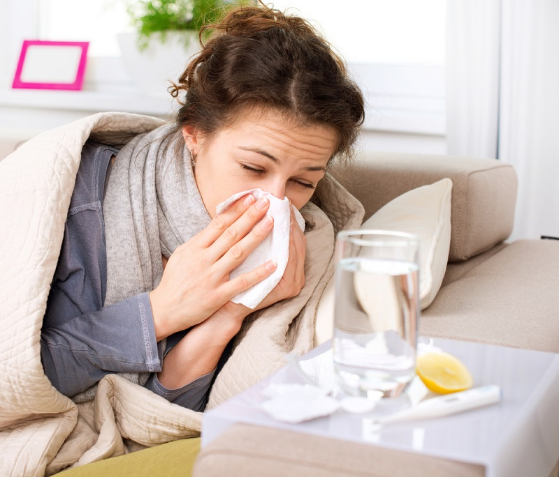 flu-or-cold-sneezing-woman-sick-blowing-nose