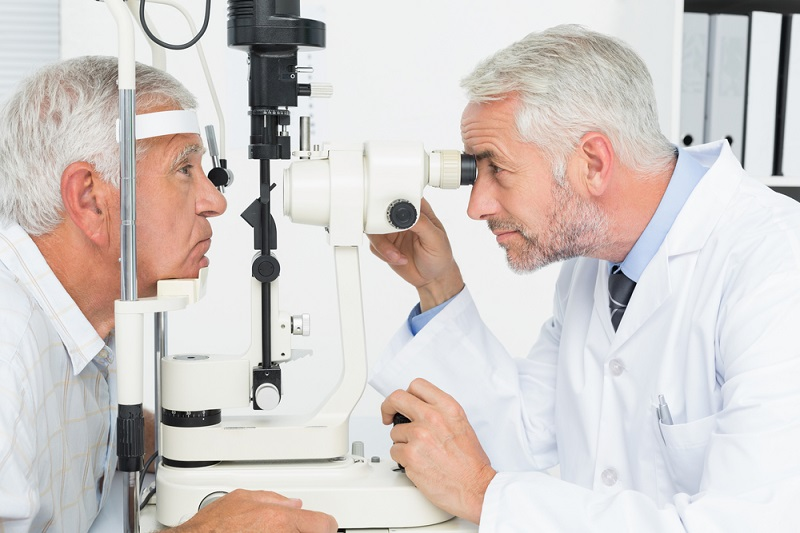 side-view-of-an-optometrist-doing-sight-testing-for-senior-patient