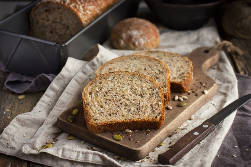 fresh-multigrain-bread-on-rustic-background