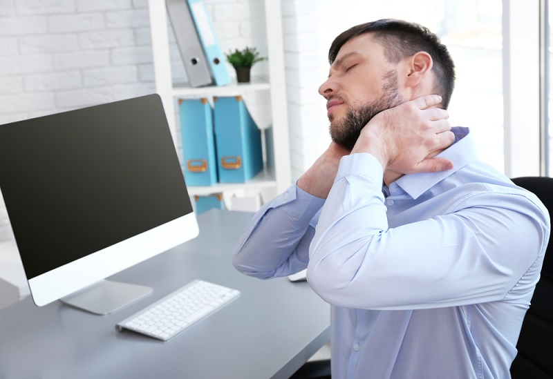 posture-concept-man-suffering-from-neck-pain-while-working-with-computer-at-office