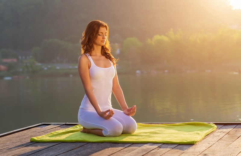 woman-yoga-relax-on-the-pier-at-the-lake