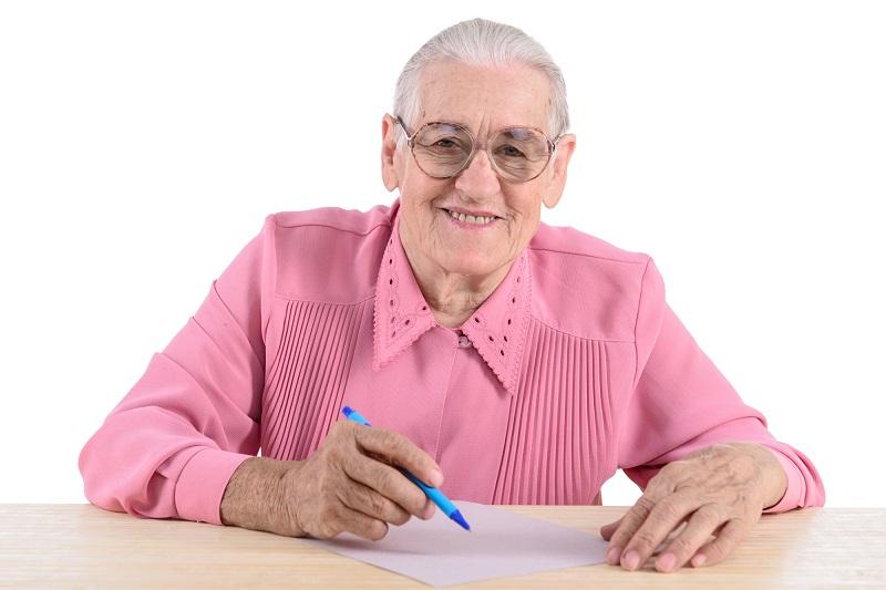 elderly-woman-writes-the-document