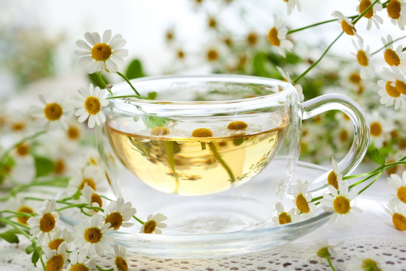 chamomile-tea-in-glass-cup-with-flowers