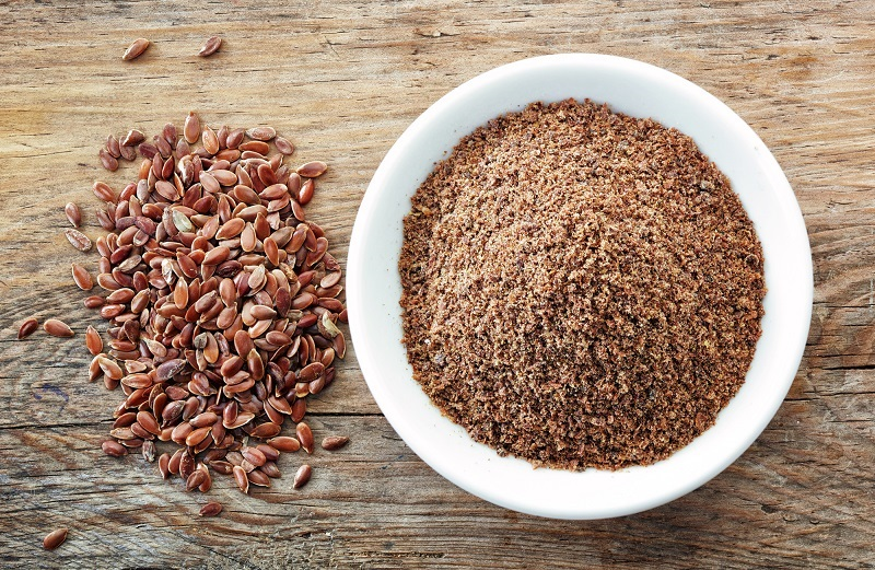 bowl-of-crushed-flax-seeds-on-old-wooden-table