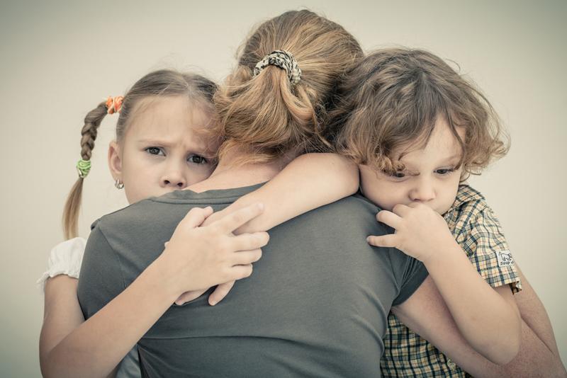 sad-children-hugging-his-mother