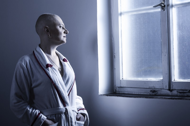bald-woman-suffering-from-cancer-looking-throught-the-hospital-w